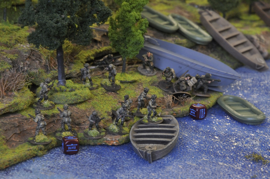US forces under fire board boats for the river crossing