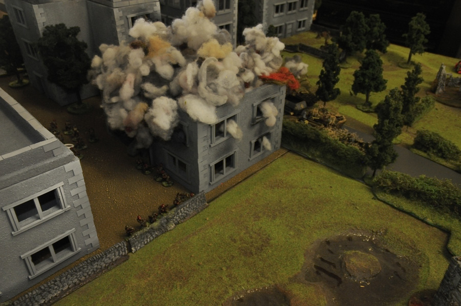 German forces from KG Von Tettau advance under fire into Arnhem past a destroyed building, whilst a section of 2nd Para watch from behind their stone wall defensive position.