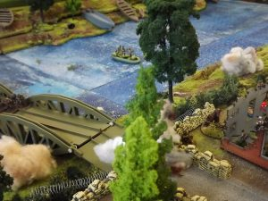 Downstream, an assault goes in, using boats.