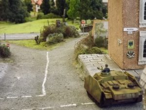 Stug waiting to counter attack from the town on the unsuspecting flank.